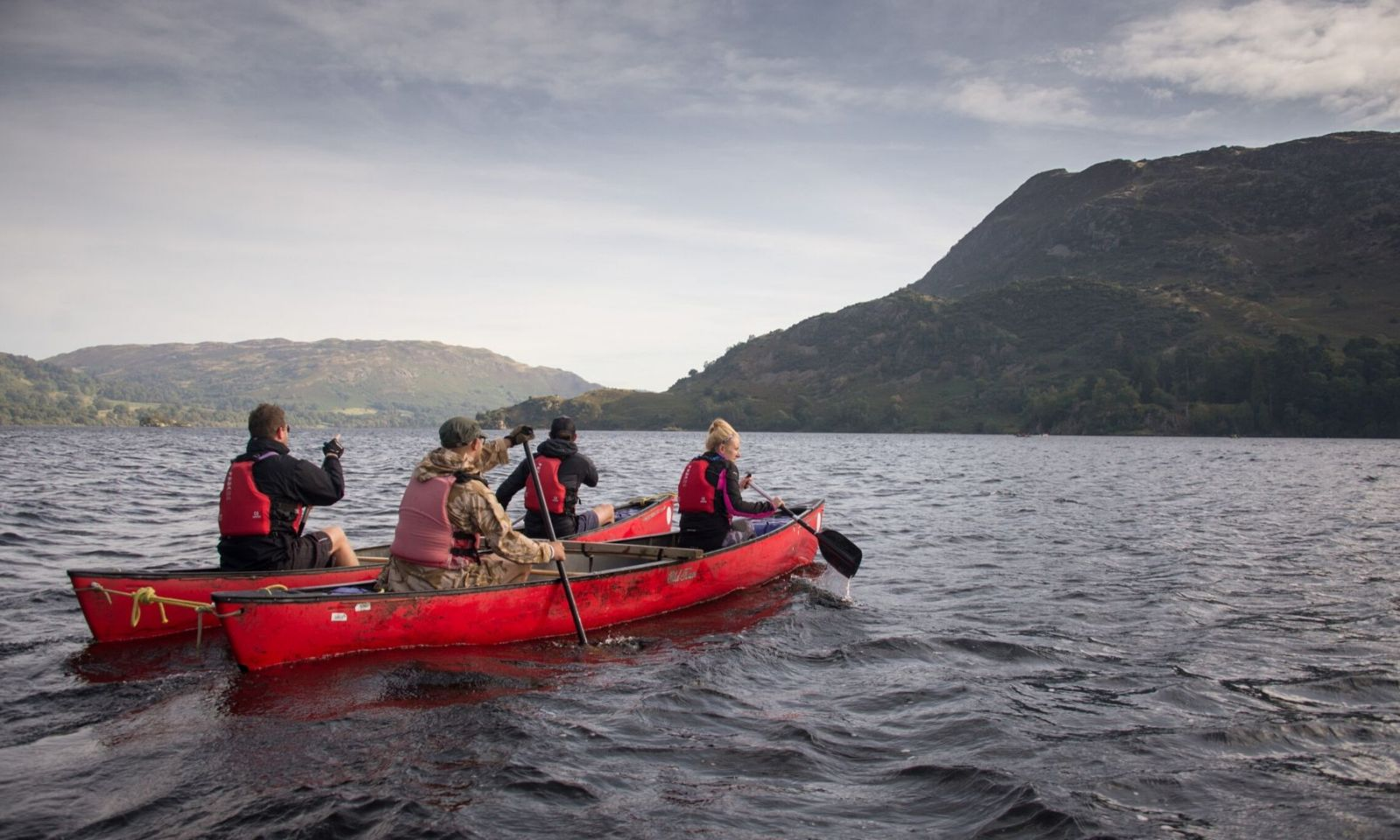 A group in canoes on Ullswater during a challenge event.