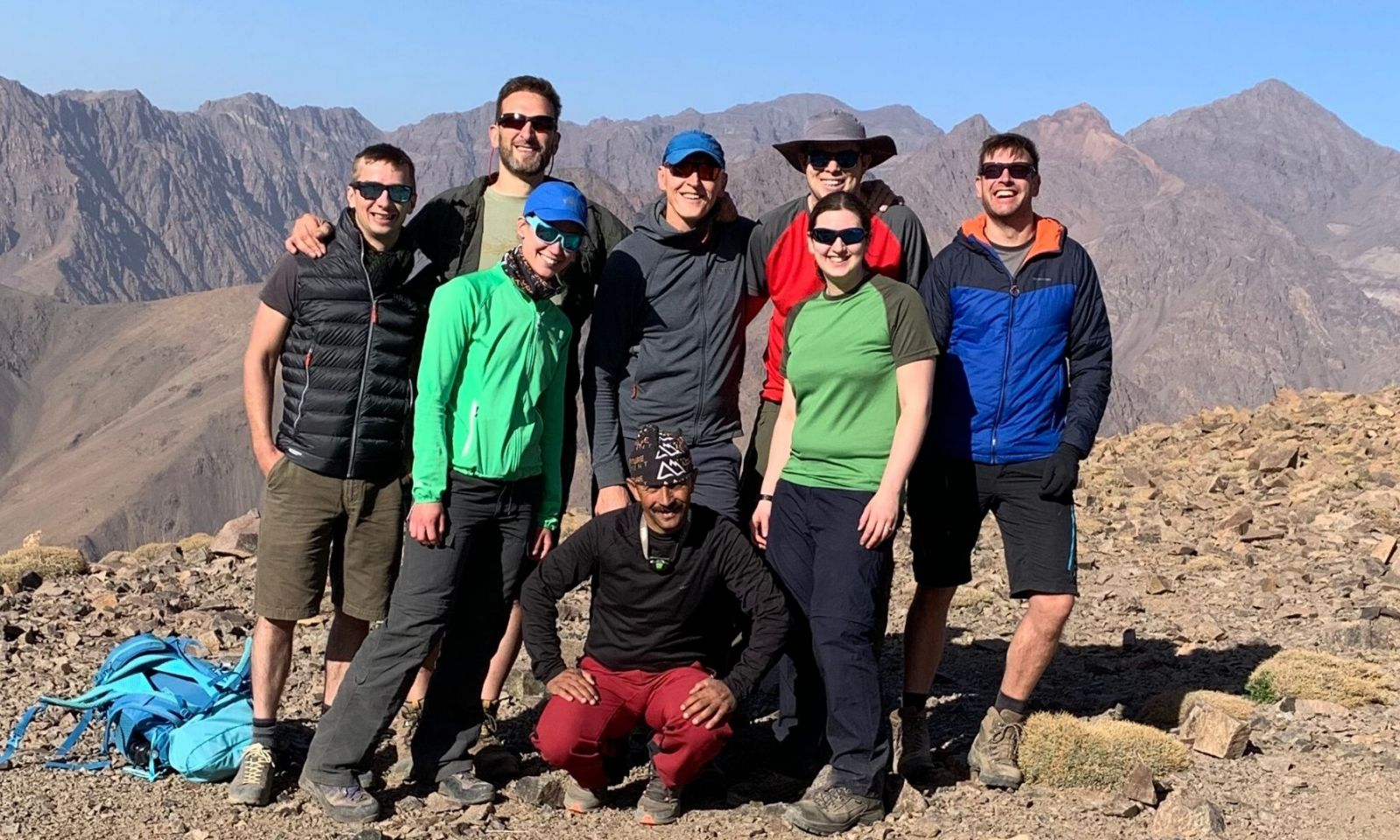 Group standing together in Morocco with mountains.